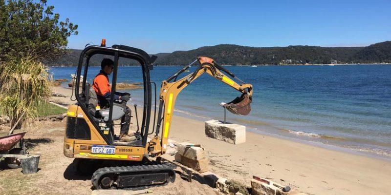 sea wall stone excavator